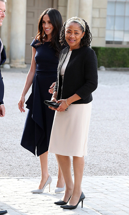 "On her wedding eve, Meghan Markle arrived at Cliveden House in the village of Taplow near Windsor wearing coordinated tailored neutrals with her mother, Doria Ragland. When asked how she was feeling, the future bride told the press, ""Wonderful, thank you.""