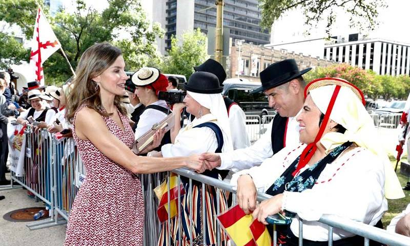 The 45-year-old looked stunning as she greeted fans in a sleeveless red dress which featured a bold pattern.