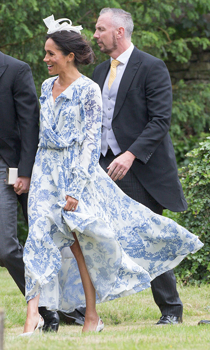 The Duchess of Sussex attended the wedding of Princess Diana's niece alongside her husband Prince Harry wearing a flowing blue and white Oscar de la Renta gown with white pumps  featuring cut-outs around the heel and a white fascinator. She looked every inch the British wedding guest!
