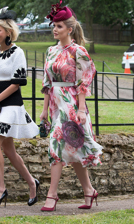 An English rose! Lady Kitty Spencer donned a $6,700 Dolce and Gabbana floral-print dress with burgundy heels and a matching veiled fascinator by Philip Treacy for a family wedding on Sunday (June 17). The style icon was recently revealed as the new face of Bulgari.