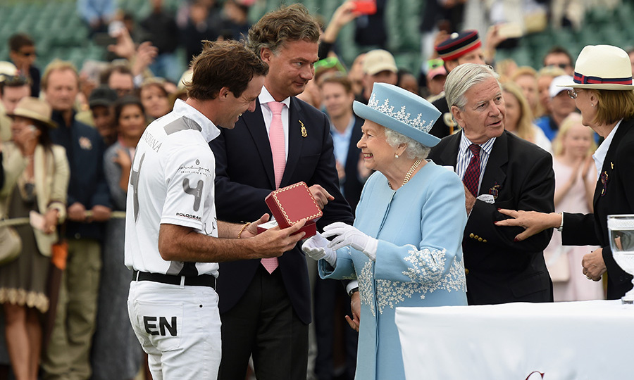 The Queen looked beautiful in blue as she handed out a winner's trophy alongside Laurent Feniou, the Managing Director of Cartier, at the Cartier Queen's Cup Final at Windsor Great Park in Berkshire on June 17. The Duke of Edinburgh, who recently underwent hip surgery and missed Trooping the Colour this year, made a rare public appearance at the event alongside his wife. 