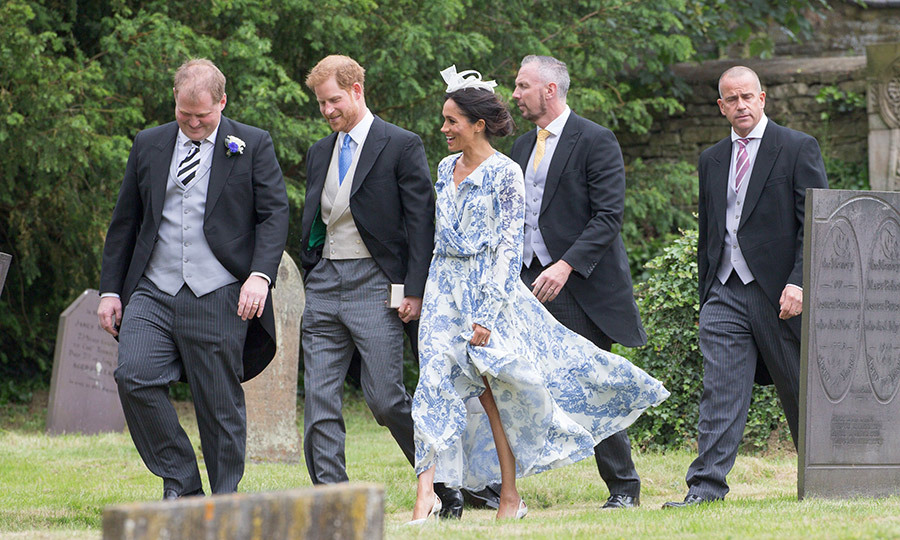 Prince Harry and his new wife Meghan attended the wedding of Celia McCorquodale, Princess Diana's niece, in Lincolnshire on June 16. The newlyweds looked picture-perfect in coordinating ensembles - his a suit with tails and a blue tie, hers a blue-and-white Oscar de la Renta gown with matching white accessories. 