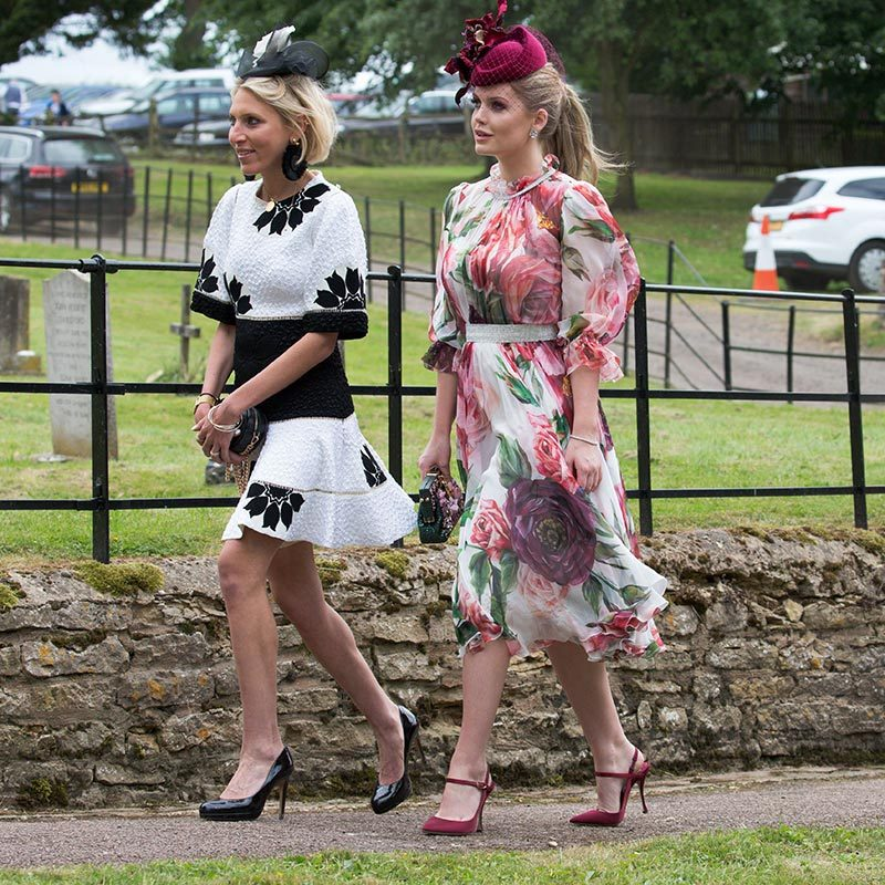 Lady Kitty Spencer attended a family wedding in Lincolnshire alongside Prince Harry and Meghan on June 16, where the Dolce & Gabbana model and face of Bulgari donned a floral dress by the Italian label along with a burgundy Philip Treacy fascinator.