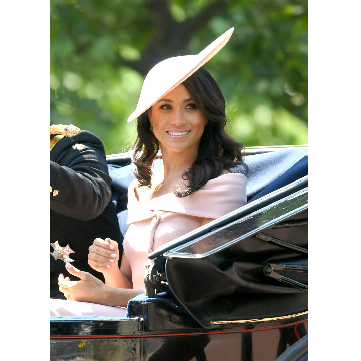 Meghan Markle attended her first Trooping the Colour in a custom Carolina Herrera ensemble that featured an off-the-shoulder neckline, dazzling crowds in a carriage with husband Prince Harry and on the balcony of Buckingham Palace - where she chatted animatedly with her husband, Prince Charles, Camilla and Duchess Kate.