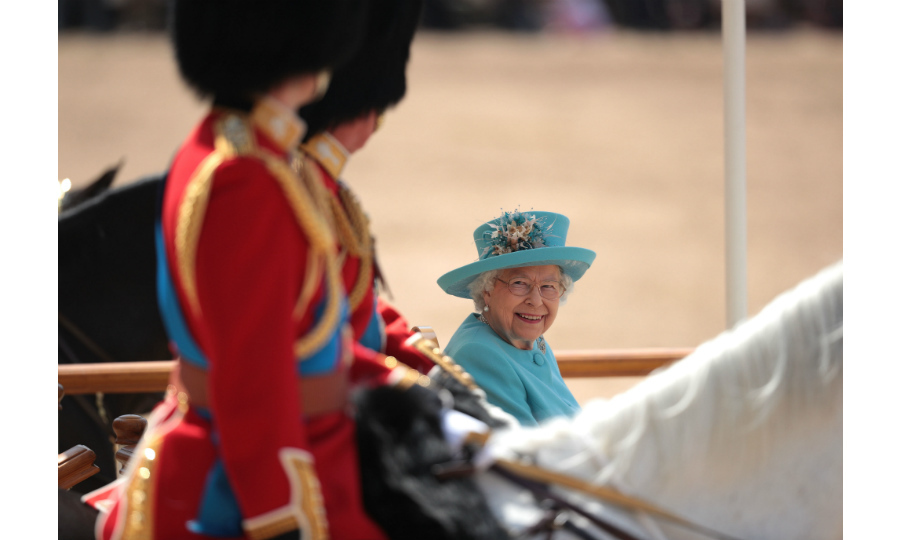 The Queen had a big smile on her face as she  passed her son Prince Andrew and grandson Prince William during the Trooping the Colour parade. Her Majesty was dressed in a festive blue ensemble with one of her signature matching hats.