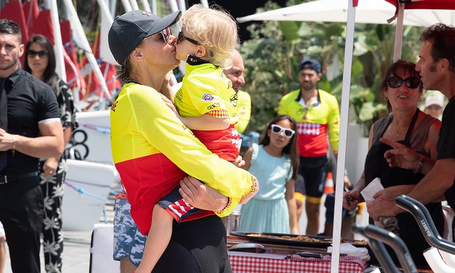 Awww! Princess Charlene of Monaco planted a smooch on son Prince Jacques during the Riviera Water Bike Challenge 2018 on June 17 in Monaco.