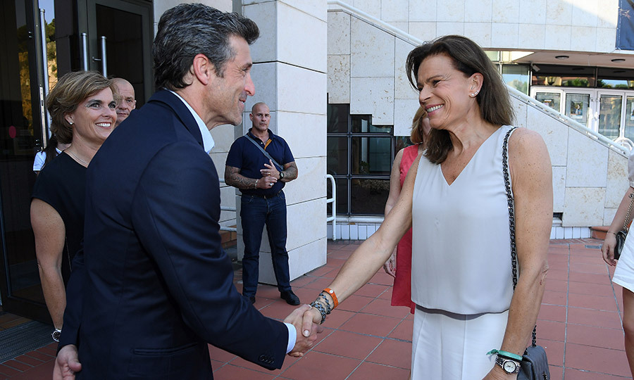 Who was more starstruck? Princess Stephanie showed off her megawatt smile while shaking Patrick Dempsey's hand as she arrived for the event, which showcased her brother Prince Albert's car collection.