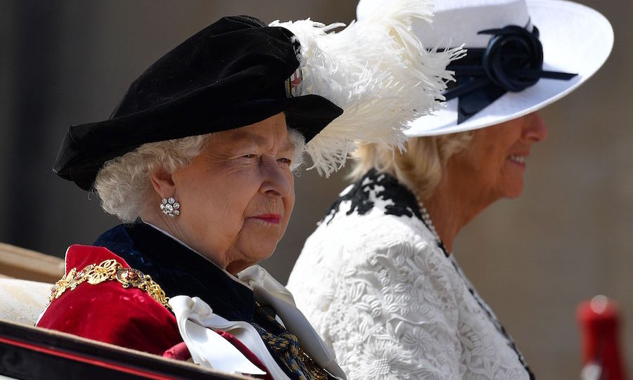 Queen Elizabeth II and the Duchess of Cornwall arrived together to attend the Order of the Garter Ceremony. The Queen looked calm and content in her regalia and beautiful earrings, sided by Camilla dress all in white.