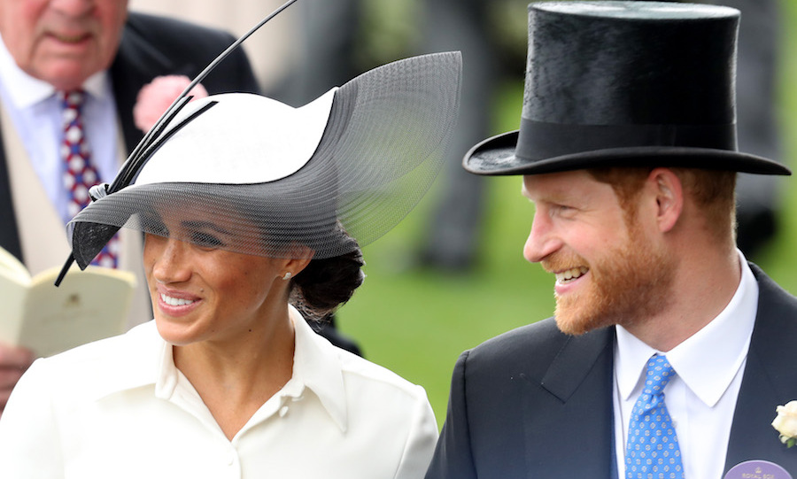 The new Duke and Duchess of Sussex looked happy as ever attending their first Royal Ascot as a married couple. Meghan stunned in a white-and-black ensemble by Givenchy, featuring a beautiful matching Philip Treacy headpiece, while Harry looked dapper in his top hat and suit.