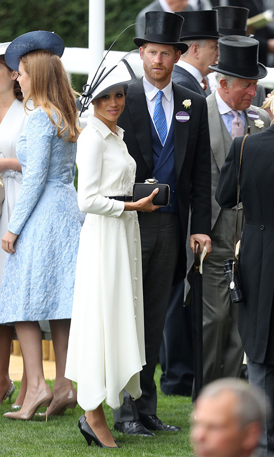 Meghan donned a chic monochrome ensemble by her go-to designer Clare Waight-Keller for Givenchy - who was also behind her wedding gown - and Philip Treacy, while her husband wore a dapper suit with blue vest and tie and top hat.