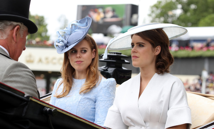 Princess Beatrice was pretty in pale blue lace with a matching fascinator while her sister, bride-to-be Princess Eugenie, wore a kimono-style white dress with angled white hat. 