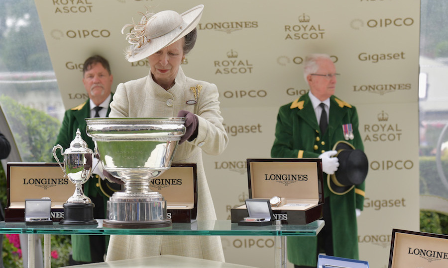 Princess Anne inspected the beautiful trophies.