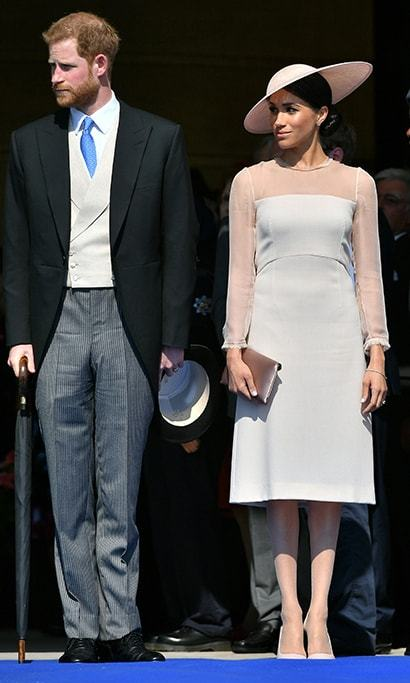 Meghan chose the perfect hat for her first royal outing as the Duchess of Sussex in May 2018! While attending a garden party for Prince Charles at Buckingham Palace, the royal looked demure and elegant in the nude 'Flavia' dress by Kate's go-to-designer GOAT. She paired the look with a chic pale-pink hat by Philip Treacy, a rose gold clutch by Wilbur & Gussie and Manolo Blahnik BB 90 heels.