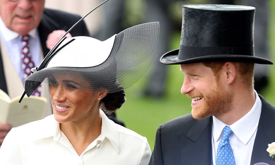 For the Duchess of Sussex's first Royal Ascot outing, the glamorous royal paired her Givenchy shirt dress with an elaborate black-and-white Philip Treacy hat.