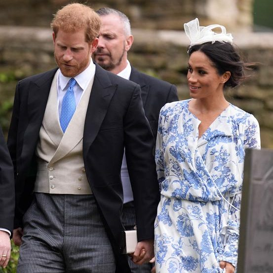 Stepping out for the wedding of Princess Diana's niece, Celia McCorquodale, Meghan went with a small white fascinator that perfectly complimented her blue-and-white Oscar de la Renta gown.
