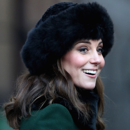 Kate is the Duchess of faux fur hats! She wore a black one on her royal visit to Sweden on January 30.