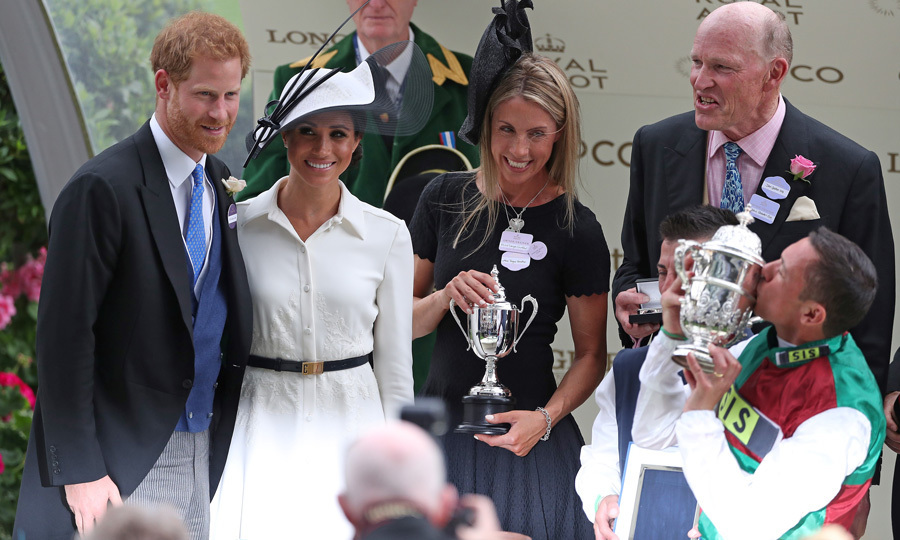 On their one-month anniversary, Meghan Markle joined her husband at the Royal Ascot 2018. The Duchess of Sussex stunned in a white Givenchy shirtdress for the occasion and helped present the winning jockey Frankie Dettori his trophy. Meghan complemented her look with a fascinator by royal favorite Philip Treacy.