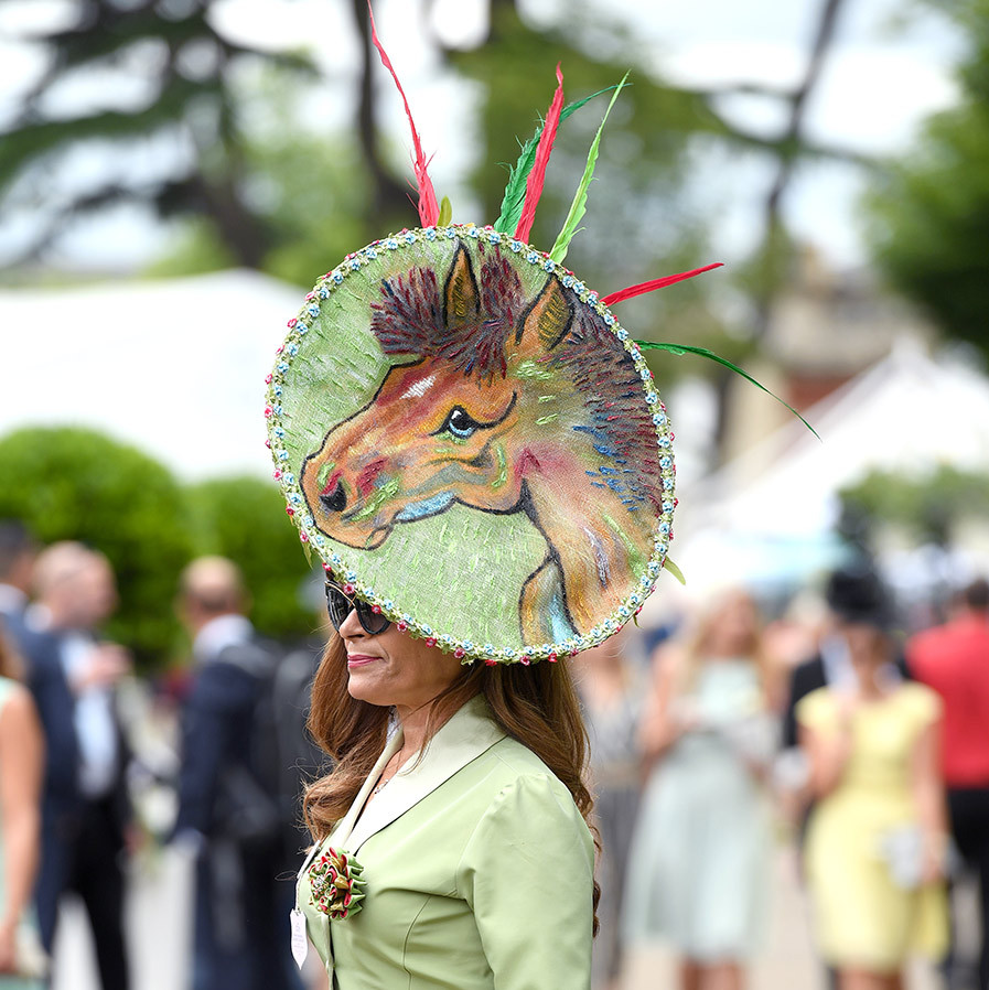 This attendee was horsing around with her headpiece - a colourful painted picture of an equine character complete with feather flourishes!