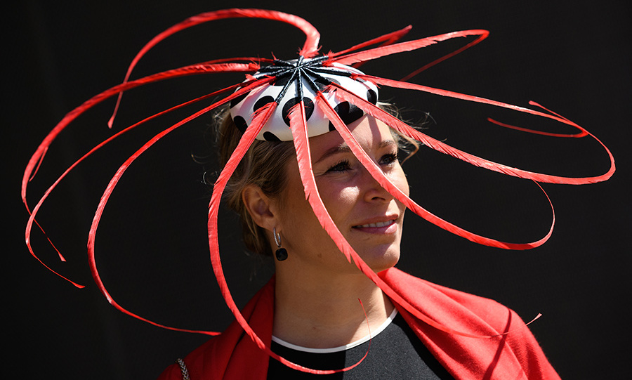 Racegoer <strong>Katrin Fahrenbruck</strong> had fellow revellers seeing red thanks to her feathery spiral topper.