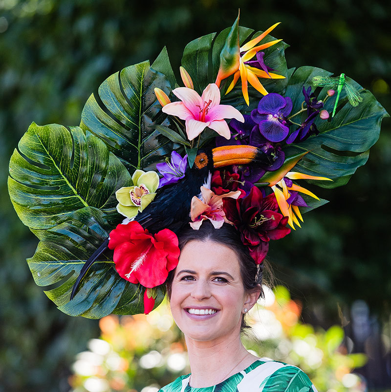 This attendee brought a taste of the tropics to the races on a sunny day, donning an oversized confection that included philodendron leaves, orchids, birds of paradise and a Toucan to boot!