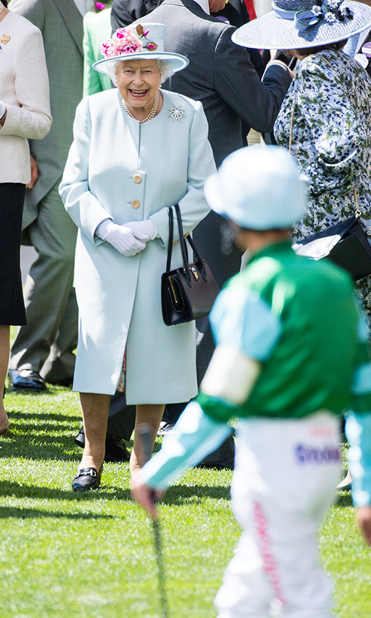 The Queen only had smiles for her jockey! Her Majesty looked lovely in her second look at the races, a pale-blue coat with a beautiful brooch and matching hat featuring pink flowers.