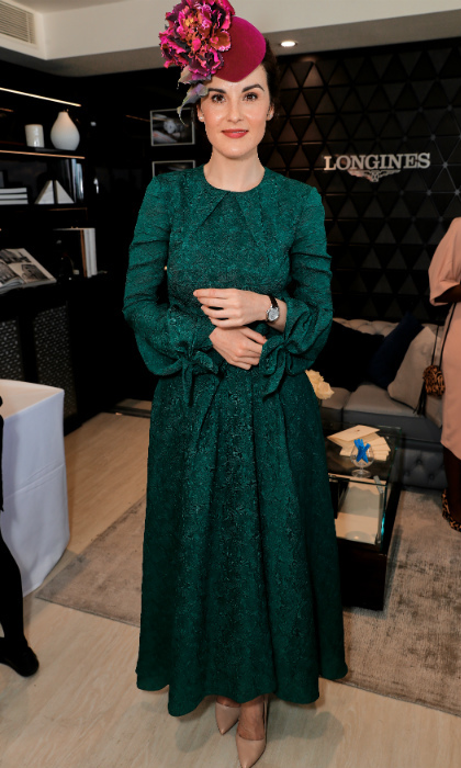 <i>Downton Abbey</i>'s Michelle Dockery, who looked stunning in a hunter green dress and elaborate floral fascinator, joined the royals for a day of racing. 