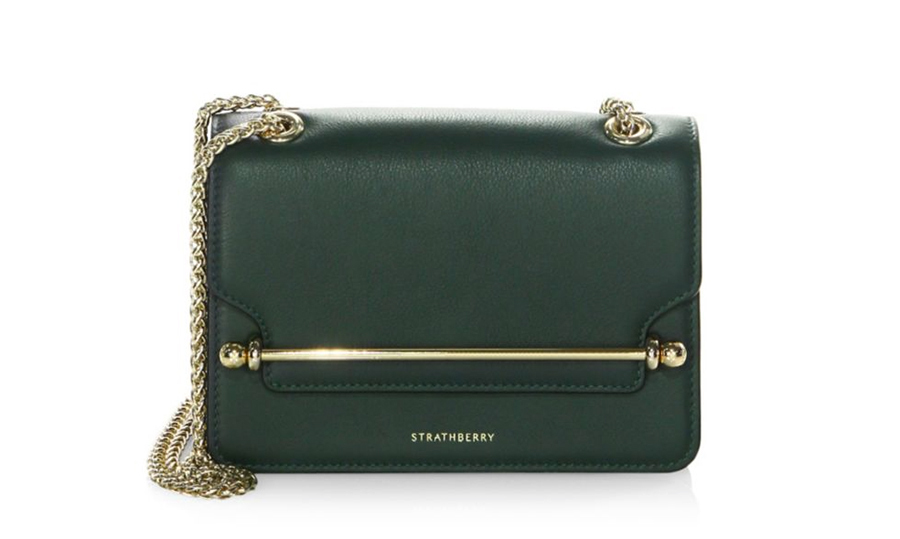 "<strong>Strathberry Mini East West Crossbody Bag in Bottle Green, $780, <a href=""https://www.saksfifthavenue.com/main/ProductDetail.jsp?PRODUCT%3C%3Eprd_id=845524447149964""><em>saks.com</em></a></strong>"