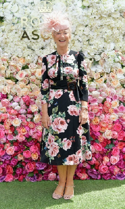 Dame Helen Mirren made a fitting fashion choice for day 5. The actress looked fabulous in a floral dress and pink hat as she posed against the wall of flowers.