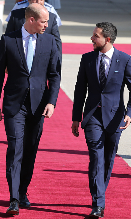 The two royals chatted as they walked down the carpet leading from the Duke's plane.