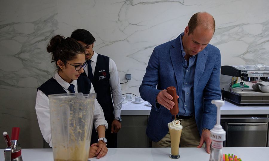 At AlQuds College, the prince transformed into a barista as he joined students in the training kitchen for a lesson in coffee-making.