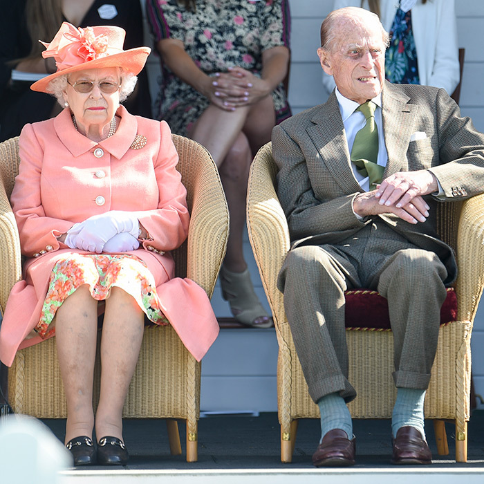 The Queen and Prince Philip were in good spirits while watching the match, with Queen Elizabeth stunning in peach!