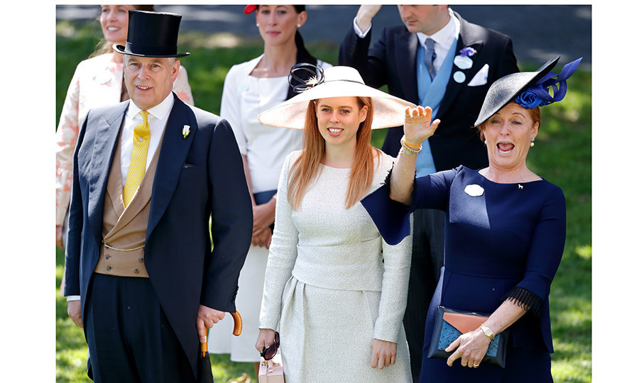 Ever the life of the party, Sarah, Duchess of York also couldn't contain her excitement when the Queen passed by in her carriage. She stood with daughter Princess Beatrice in a very wide-brimmed hat and ex-husband Prince Andrew. 