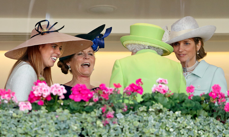 Princess Beatrice, her mom Sarah Ferguson and Lady Carolyn Warren joined the Queen in the Royal Box during the King Edward VII stakes, where the monarch had the group in stitches!