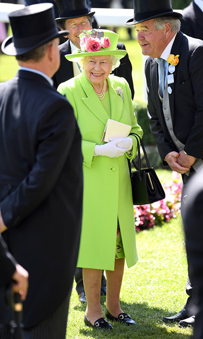The Queen wore one of her signature colours on her fourth consecutive day at the races. The 92-year-old is a longtime lover of horses and horse racing, so it's no wonder she has had a smile on her face for days!