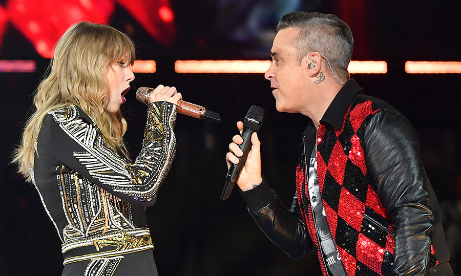 "The musical duo of our ""Wildest Dreams""! Taylor Swift and Robbie Williams took to the Wembley Stadium stage on June 23 in London.
