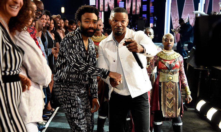 Donald Glover and host Jamie Foxx stopped for a photo together at the 2018 BET Awards on June 24.