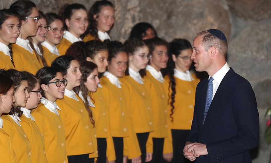 The prince met members of a youth choir who performed for the royal in the Hall of Names.