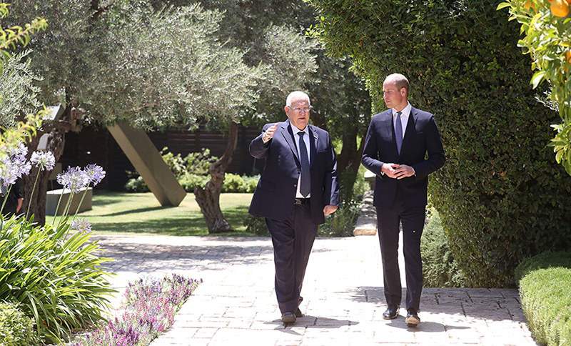 The prince and president took a walk outside in the beautiful sunshine of Jerusalem, along a path lined by orange trees.