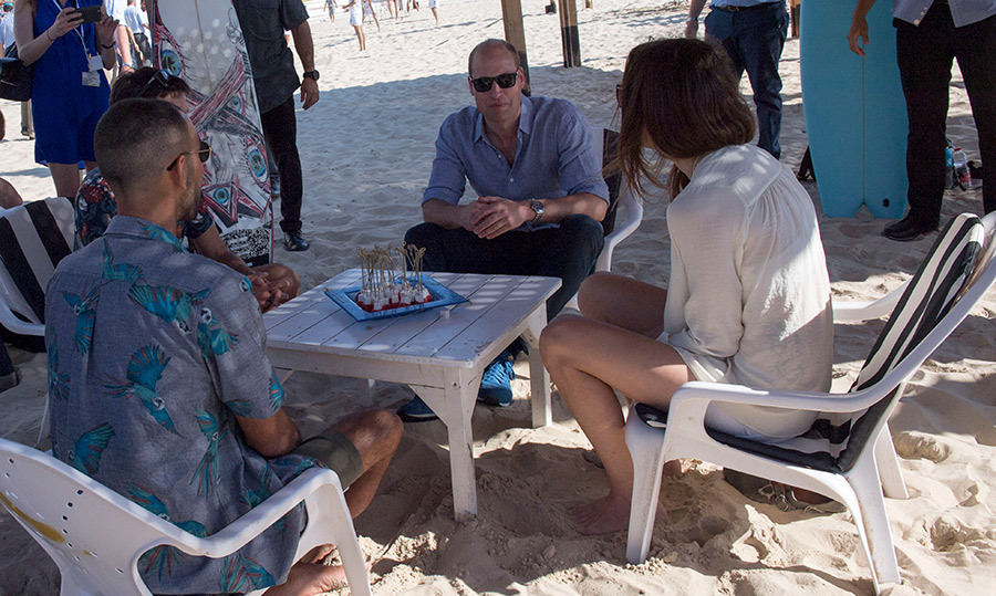William took a reprise from the sun to chat with some locals in the sand.