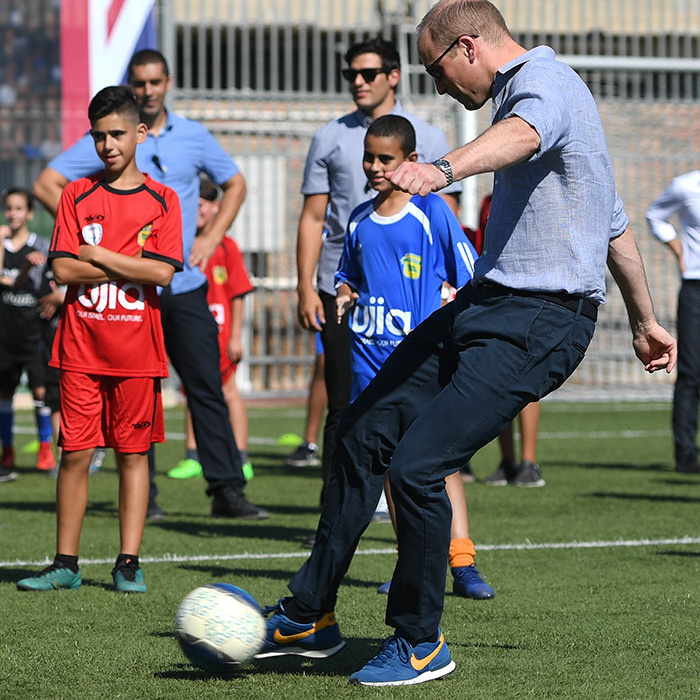 Of course, he had to show the young ones some of his fancy footwork! William kicked around a soccer ball during a session at the Equalizer football program in Jaffa, Israel.