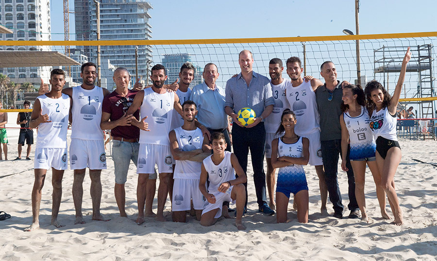 On day three of his tour, the prince found his way to the beach! He posed with a volleyball team before watching them play a match.