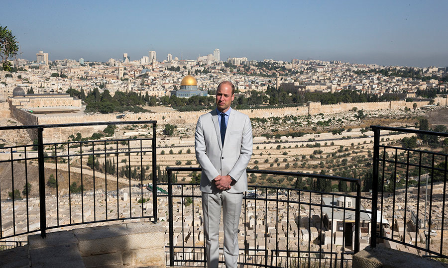 Who says royals can't be tourists, too? The prince took a moment to pose on the Mount of Olives, which overlooks the stunning landscape of Jerusalem.