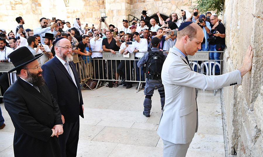 Prince William visited the Western Wall, Judaism's holiest place of prayer, with the British chief Rabbi Ephraim Mirvis and Western Wall chief Rabbi Shmuel Rabinovitch.