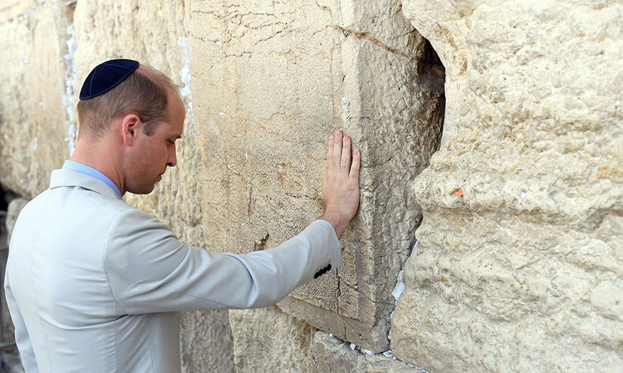 The royal stopped for an emotional moment of prayer at Jerusalem's Western Wall.