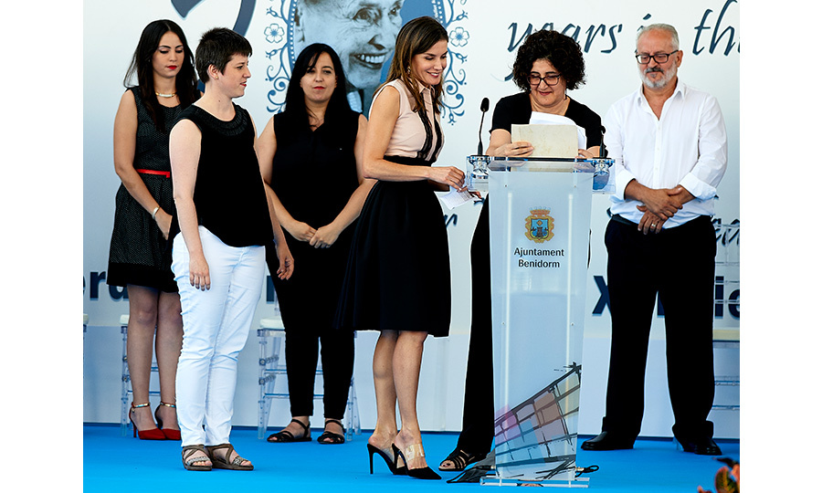 Queen Letizia spent a day in the seaside town of Benidorm, Spain as she attended the International day of Deafblind People celebrations. The monarch gave a speech looking  ladylike in a full black skirt, pink and black sleeveless blouse and black mules with a clear strap. 