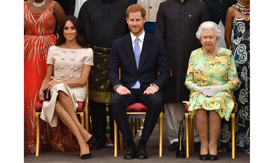 Prince Harry and Meghan were keen to celebrate youth  making a difference in Commonwealth countries alongside Her Majesty at the Queen's Young Leaders Awards. Prince Harry gave a speech at the event, which was co-hosted by his wife the Duchess Of Sussex. Meghan was clad in a pretty pink Prada suit, while her grandmother-in-law opted for a summer green dress featuring yellow and orange flowers. 