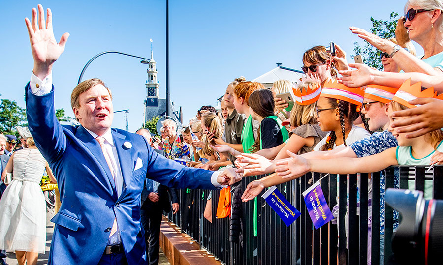 King Willem-Alexander waved to fans during their visit in Hoorn, Netherlands.