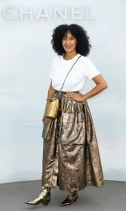 Tracee Ellis Ross brought the glitz to the Chanel Haute Couture show courtesy of her bronzy skirt and boots, which she paired with a simple white tee.