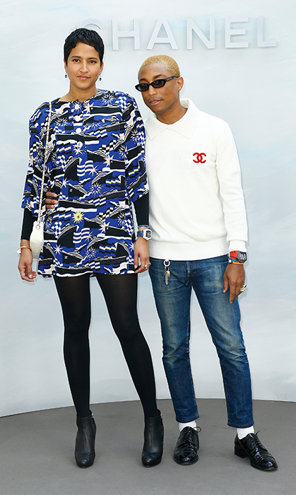 Beautiful couple Helen Lasichanh and Pharrell Williams posed for a stylish snap at Le Grand Palais.