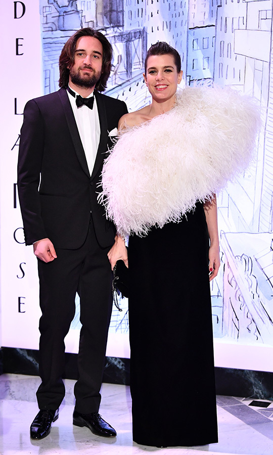 Yves Saint Laurent was responsible for the feathery confection that drew attention away from Charlotte's budding baby bump back in March. The beautiful brunette was out with fiancé Dimitri Rassam at the Monaco Rose Ball in March.